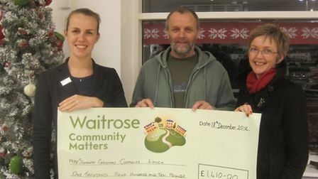 Mick and Angie Carney receive a Community Matters cheque from Ali Wallace, department manager at Wai