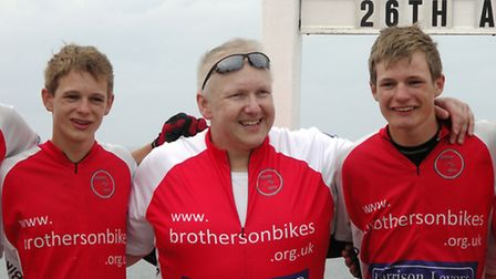 John Massen with Sam and Ollie Turner at the finishing line at Land's End