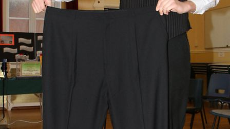 Jon Borowik from Sidmouth with a pair of his old trousers. Jon has lost a phenomenal 9 stone 3lbs si