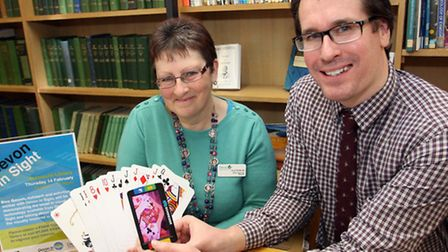 Sidmouth library supervisor Carol Pentecost with Devon In Sight outreach and activity worker Ben Gav