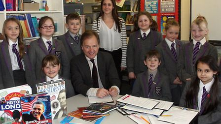 Hugo Swire MP with teacher Libby Redstone and year four school children at St Johns school in Sidmou