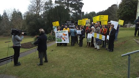 Protesters gather outside Knowle for the district council's special meeting over a planning applicat