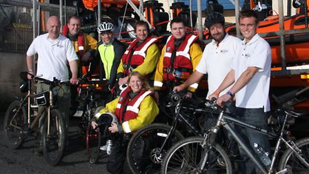 Sidmouth life boat crew with cyclists Glyn Jones,John Kennedy,Phil Marish and Michael Benzon, not in