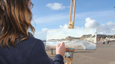 Picture This-Artist Neil Hampson works on his oil painting on Sidmouth seafront this week. The work