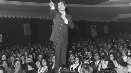 French singer and songwriter Gilbert Becaud (1927 - 2001) among the audience at the Olympia Theatre,