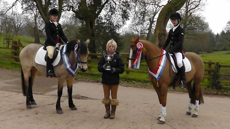 Harrison Oakley riding Copper Champions and Millie Pring reserve Champion being presented with their