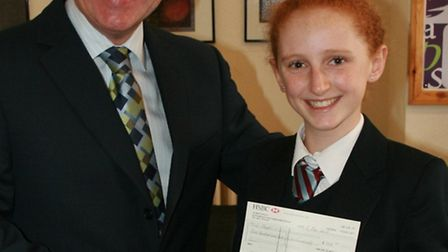 Headmaster Simon Larter presenting the cheque to competition winner Rosie Varley