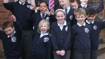 Sidmouth primary head teacher Paul Walker with school children celebrating their Ofsted report. Phot
