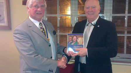 Ottery businessman Ron Miles, the proprietor of the Lamb and Flag, was inducted to the Rotary Club o