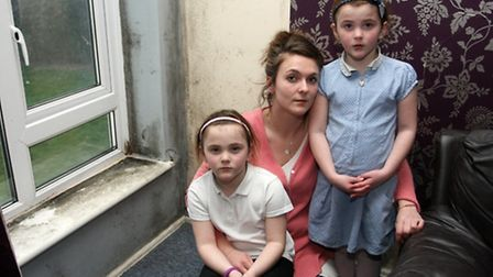 Kelly Gorman with her 5 year old twins in her mouldy flat in Sidford. Photo by Terry Ife ref shs 904