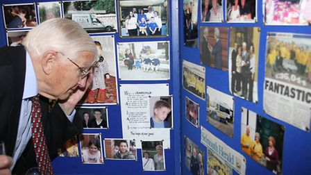 Tony Littley looking at some of Bill and Evelyn Lankester's old photos. Photo by Terry Ife ref shs 1