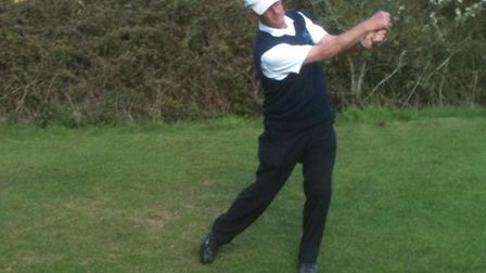 """Brian Skittrall practises his swing before his birdie on the first hole."""""""