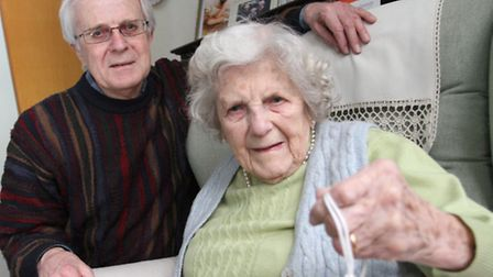 Derek Brooks is pictured with his mother Betty at her Sidford home this week holding the emergency c