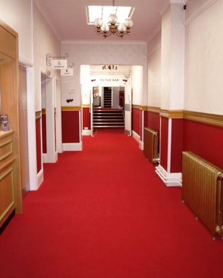 Red carpet treatment: Audiences receive a warm welcome in the freshly decorated foyer.