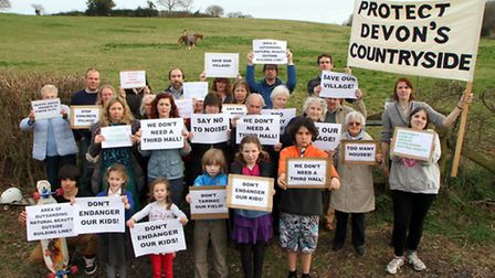 Newton Poppleford villagers protest at an area of land which is planned for the development of up to
