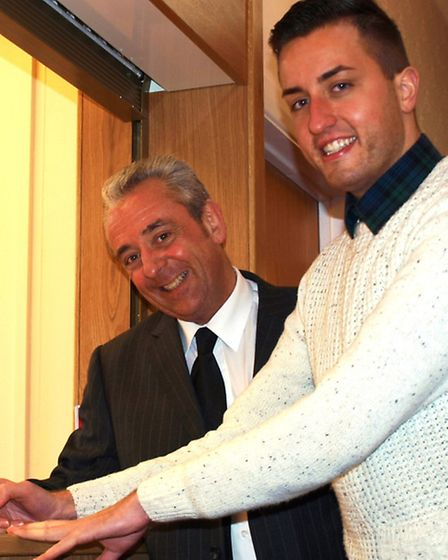 Paul Taylor Mills signs the contract for his company to spend the next three summers in Sidmouth, wa