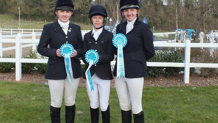 The Sid and Otter Valley show jumpers (left to right) Jasmin Carter, Harrison Oakley and Immy Carter