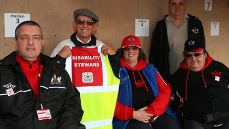 Exeter City staff who look after visiting disabled supporters (Far-left); Nick Saunders (Disability