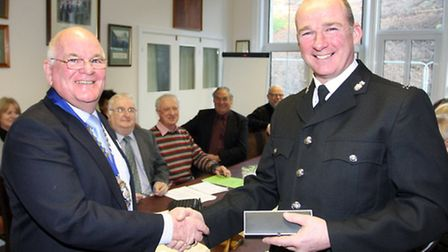 Ottery St Mary Mayor Glyn Dobson makes a presentation to retiring PC Phil Thomas. Photo by Terry Ife