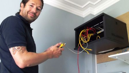 Alex Carrah of Phone & Broadband, puts the final upgrade WiFi and Broadband wiring in place at Kenna