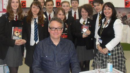 Author Charlie Higson with readers from Sidmouth College at head librarian Louise Harrison