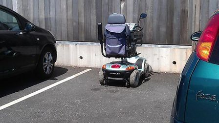 A mobility scooter in one of the parking spaces at Waitrose in Sidmouth