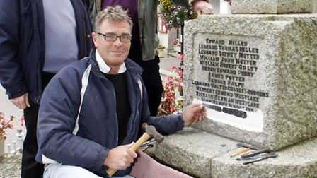 Richard Scott and Peter Anderson getting the name of Allan Newton added to the war memorial in 2011,
