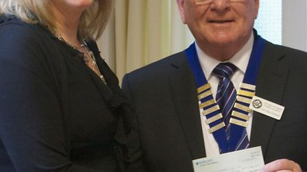 Jane Davies from the Ottery Help Scheme receiving a cheque from mayor Glyn Dobson from the Parish To