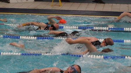 Karl Hodson (second swimmer from top) in action in the triathlon