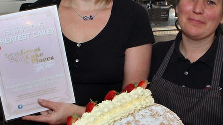 The Clock Tower Cafe are celebrating having won an award for their cakes. Pictured with their certif