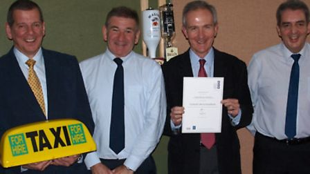Members of EDDC's licensing team with their award – held by manager John Tippin.