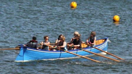 The Sidmouth ladies gig team off Teignmouth