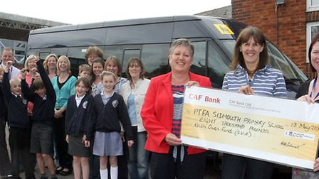 Liz Warren (left) of the Sidvale Keith Owen Fund presenting a cheque to Sarah Fletcher the chairman