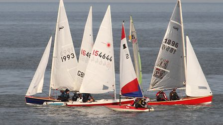 Lasers, Scorpions, a Topper and a Feva mix it up-evening sailing off Sidmouth this week. Photo by Si