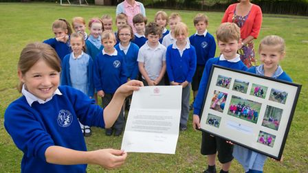 Pic by Guy Newman. 27.06.2013. Y3 Pupils from Newton Poppleford School with the letter they received