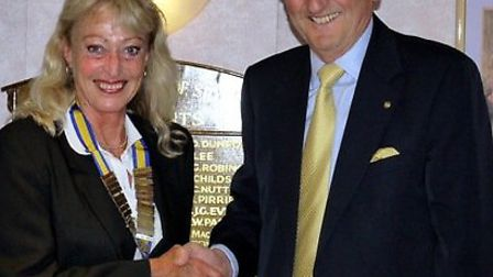 Barry Chapman hand over the presidential reins to Lynn Ellis