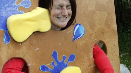 Head teacher Charlotte Hill gets bombarded by wet sponges during the Sidbury fete. Photo by Terry If