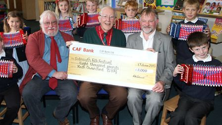 Organisers of Sidmouth Folk Festival visited Sidmouth Primary School where they receive a donation f