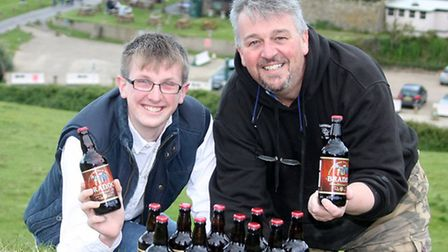 Branoc Richards on his eighteenth birthday with a bottle of the local brew given to him from Paul Di