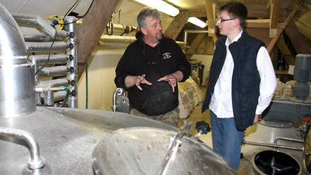 Branoc Richards on his eighteenth birthday gets a tour with Paul Dimond of Branscombe brewery. Photo