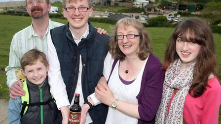 Branoc Richards on his eighteenth birthday with a bottle of the local brew given to him from Bransco