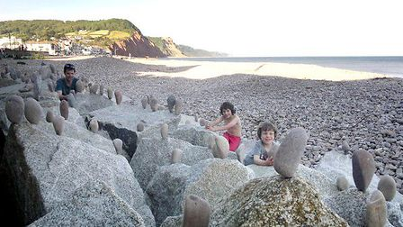 Stone balancing crowd puller! Andrew Harwood-White and sons, Sam, 10, and Joshua, five. Ref shs 2013