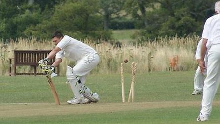 Adam Gibbins is bowled first ball!