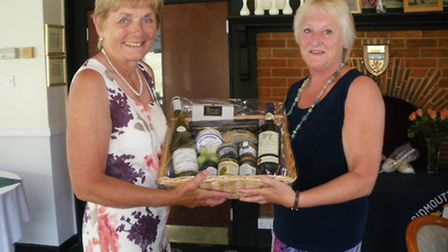 Ros Eaton (on left) presenting Jacqui Hills with her winners hamper.
