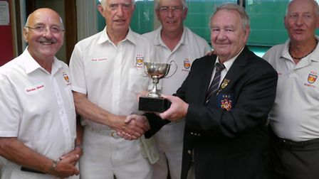 Sidmouth club president Trevor Ashton Pritchard presenting the Jubille TRophy to Bob Seldon of the w