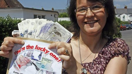 Sidmouth hospicecare nurse Julie Morris with one thousand pounds from a mystery benefactor. Photo by