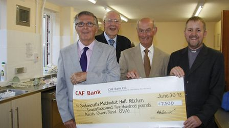 Cheque handover from John Townsend and Handel Bennett from the Sid vale association's Keith Owen fun