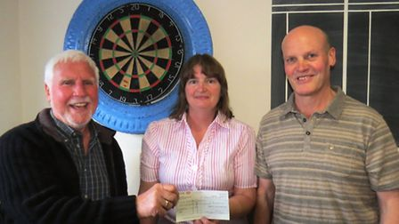 Darts club donation was welcomed by the scouts