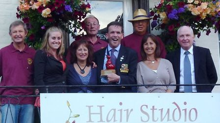 The Sidmouth Lions presenting the red duck trophy to Hilary Bevis