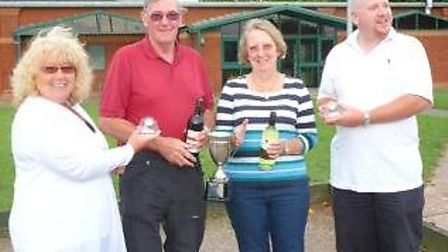 Peter Smith and Yvonne Brown receiving the cup from Jean and her son Rob Brealey.